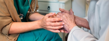 nurse holding hands of elderly woman care industry